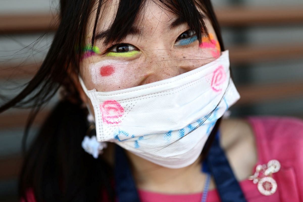 A spectator at the finish of the Women's Road Race in Tokyo, on July 25, 2021.