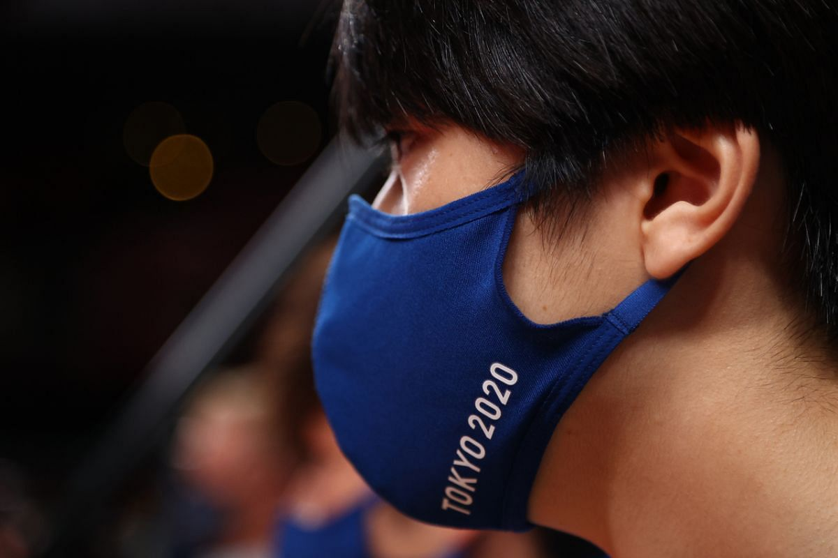 A staff member wearing a Tokyo 2020 protective face mask on July 25, 2021.