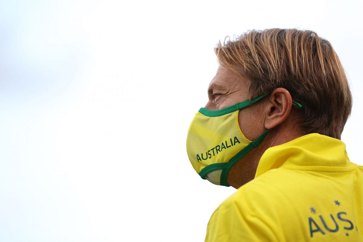 Australia football coach Tony Gustavsson is seen wearing a protective face mask before the match on July 24, 2021.