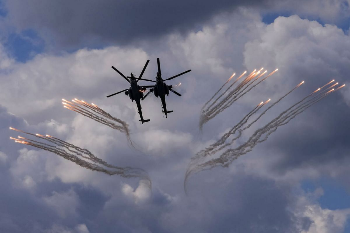 Mil Mi-28 military helicopters perform during the MAKS 2021 air show in Zhukovsky, outside Moscow, Russia, July 25, 2021.