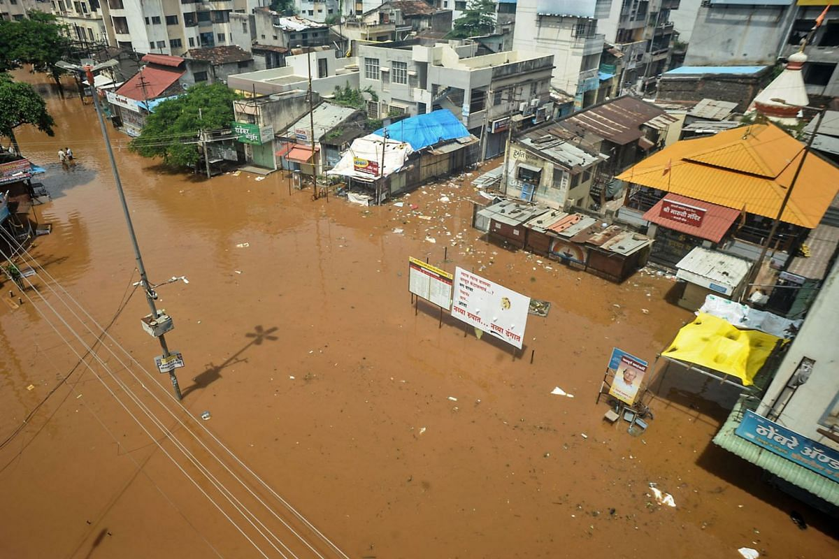 A general view of a flooded square is pictured following heavy monsoon rains at Sangli district of Maharashtra on July 26, 2021, as the death toll from monsoon-triggered landslides and floods climbed to 198.