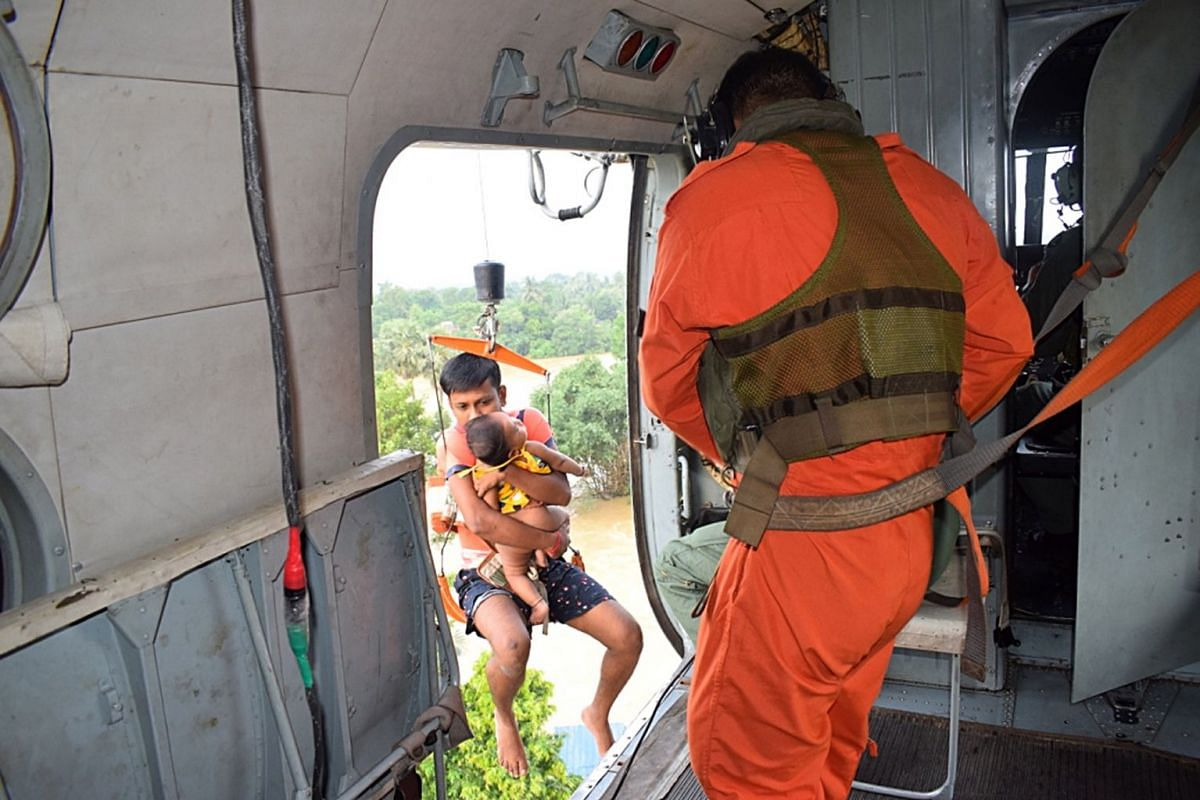 A handout photo made available by the Indian Air Force (IAF) showing an IAF helicopters during the rescue operation in flood affected areas of Dhanyaghari of Khanakul in West Bengal, India, Aug 2, 2021. According to the IAF, helicopters of Indian Air