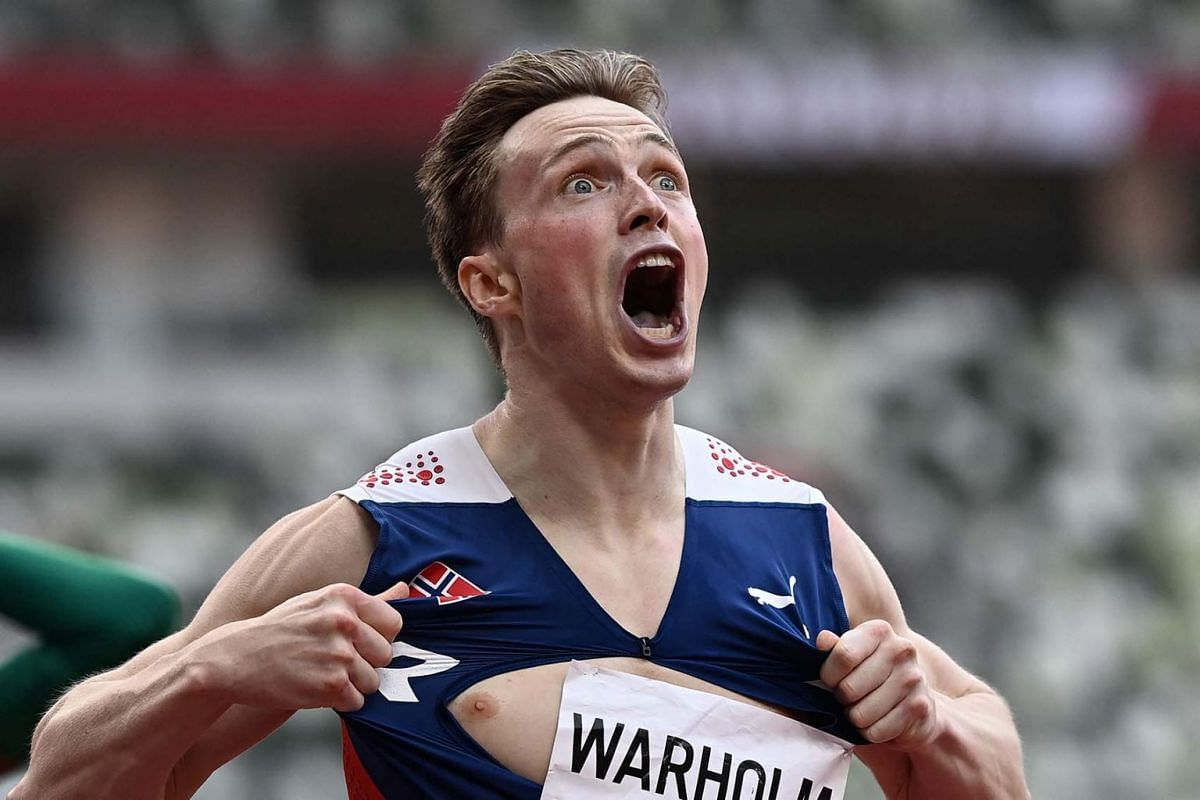 Norway's Karsten Warholm reacts after winning and breaking the world record in the men's 400m hurdles final during the Tokyo 2020 Olympic Games at the Olympic Stadium in Tokyo on August 3, 2021.