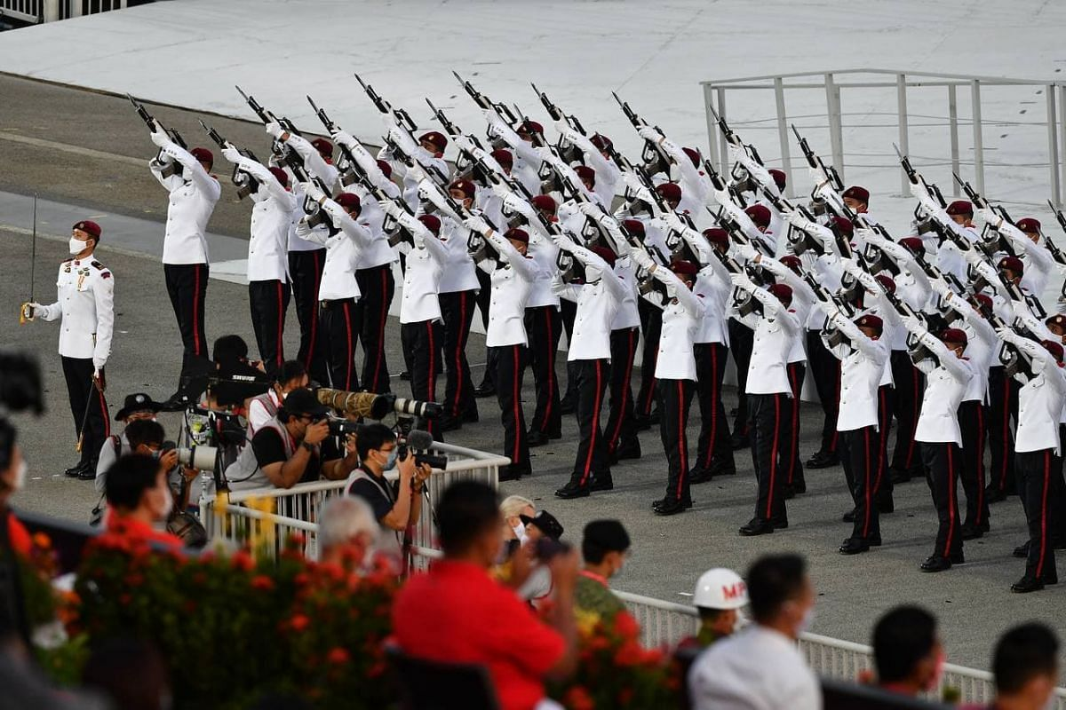 Feu de joie during the Parade and Ceremony segment on Aug 21, 2021.
