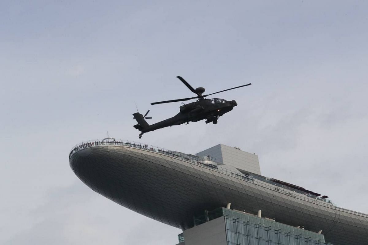 An AH-64D helicopter during an aerial display at the parade on Aug 21, 2021.