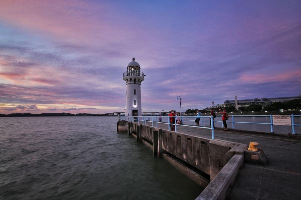 Raffles Marina Lighthouse during sunset on Aug 19, 2021.