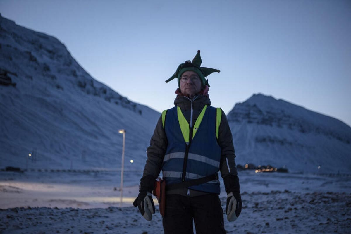 Mr Jo Tore Berg, an English teacher, on the lookout for polar bears at Longyearbyen School. For 30 minutes twice a day during the dark season, a staff member patrols the perimeter of the schoolyard while students play in the open during recess. When