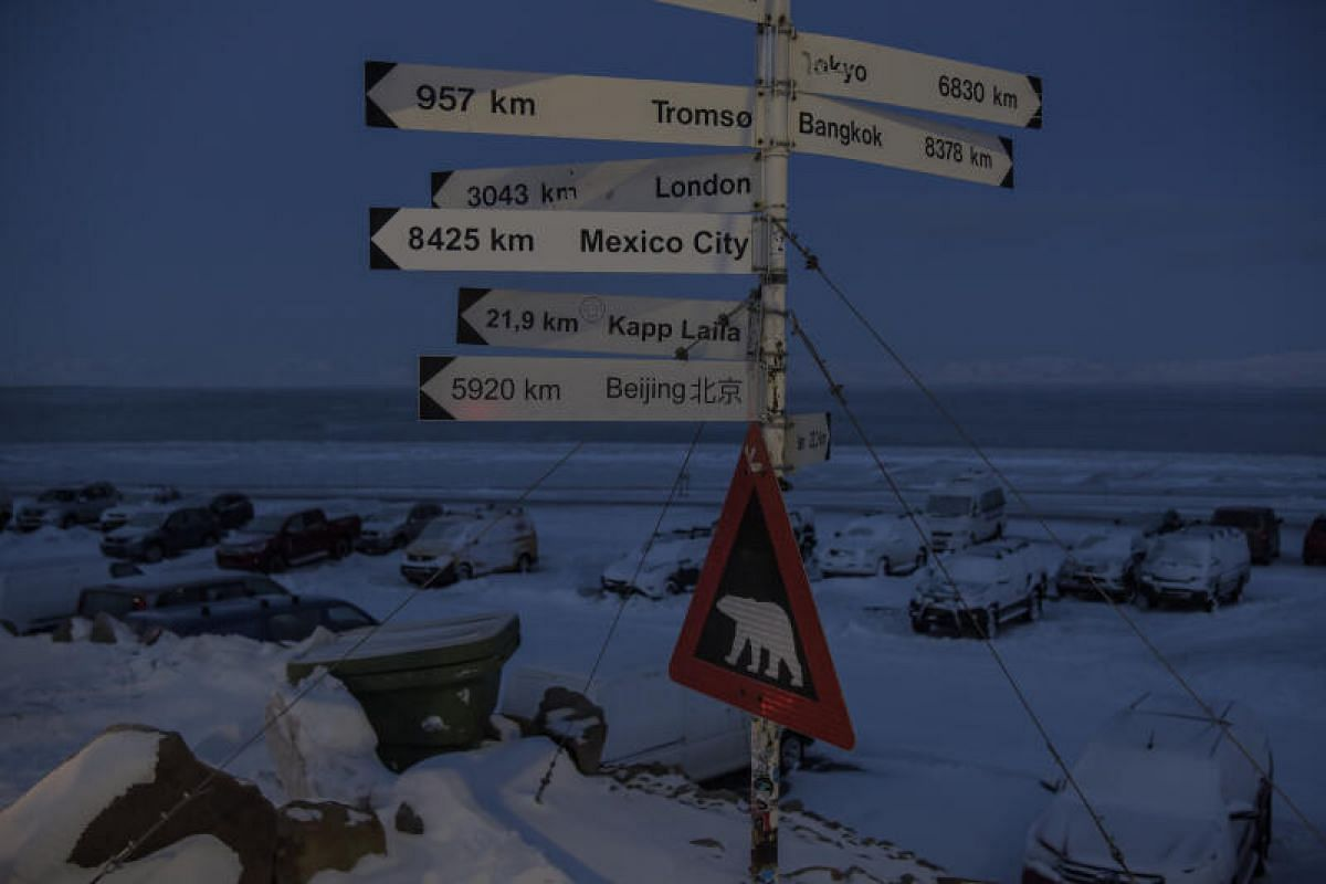 A sign showing the various distances of major cities around the world is seen at Svalbard Airport on Feb 6, 2020.