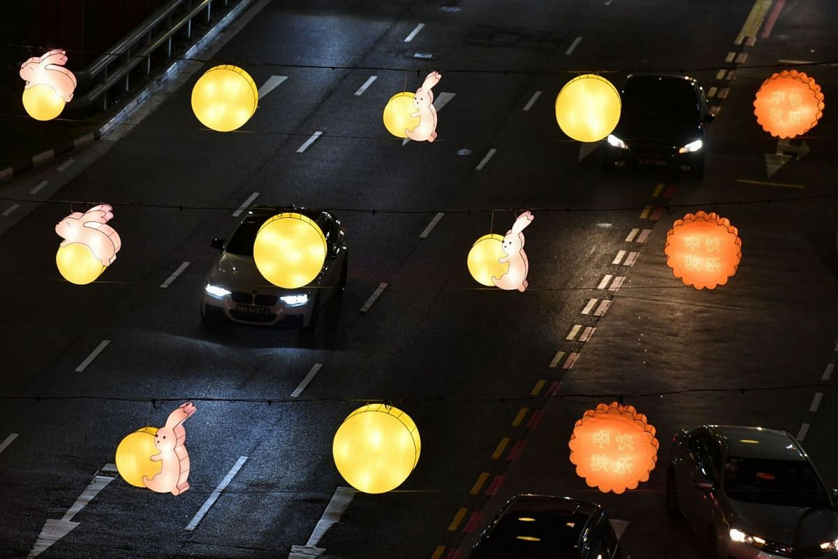 Lanterns shaped like mooncakes and jade rabbits line the streets of Chinatown on September 7, 2021.