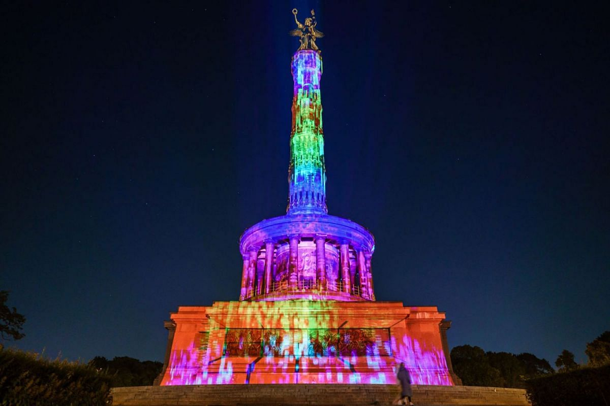 The Victory Column is illuminated during the Festival of Lights in Berlin, Germany, September 3, 2021.