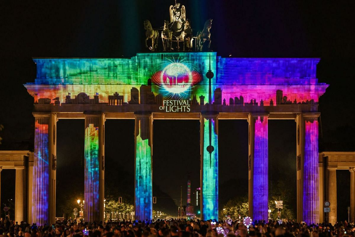 The Brandenburg Gate is illuminated during the Festival of Lights in Berlin, Germany, September 3, 2021. During the festival, buildings and landmarks of the German capital are screened with light installations and 3D projections.