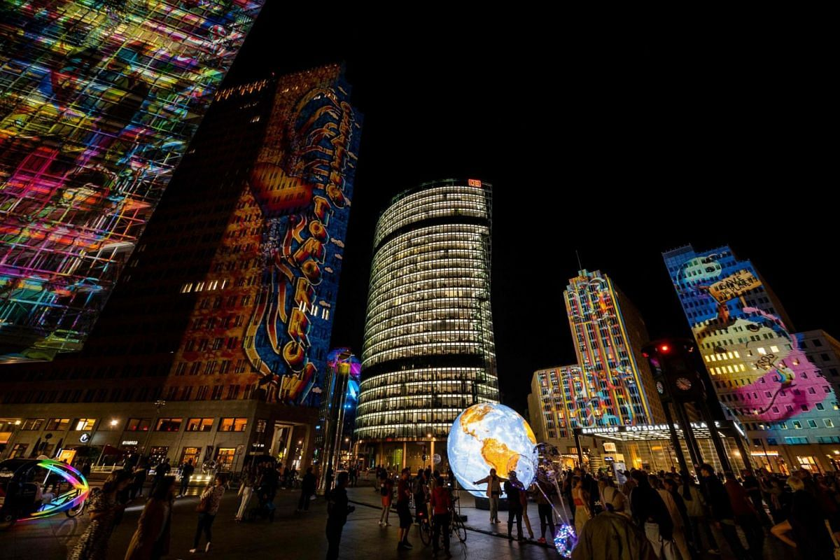 Light designs are projected onto high-rise building at the Potsdamer Platz as part of the yearly Festival of Lights in Berlin on September 8, 2021.