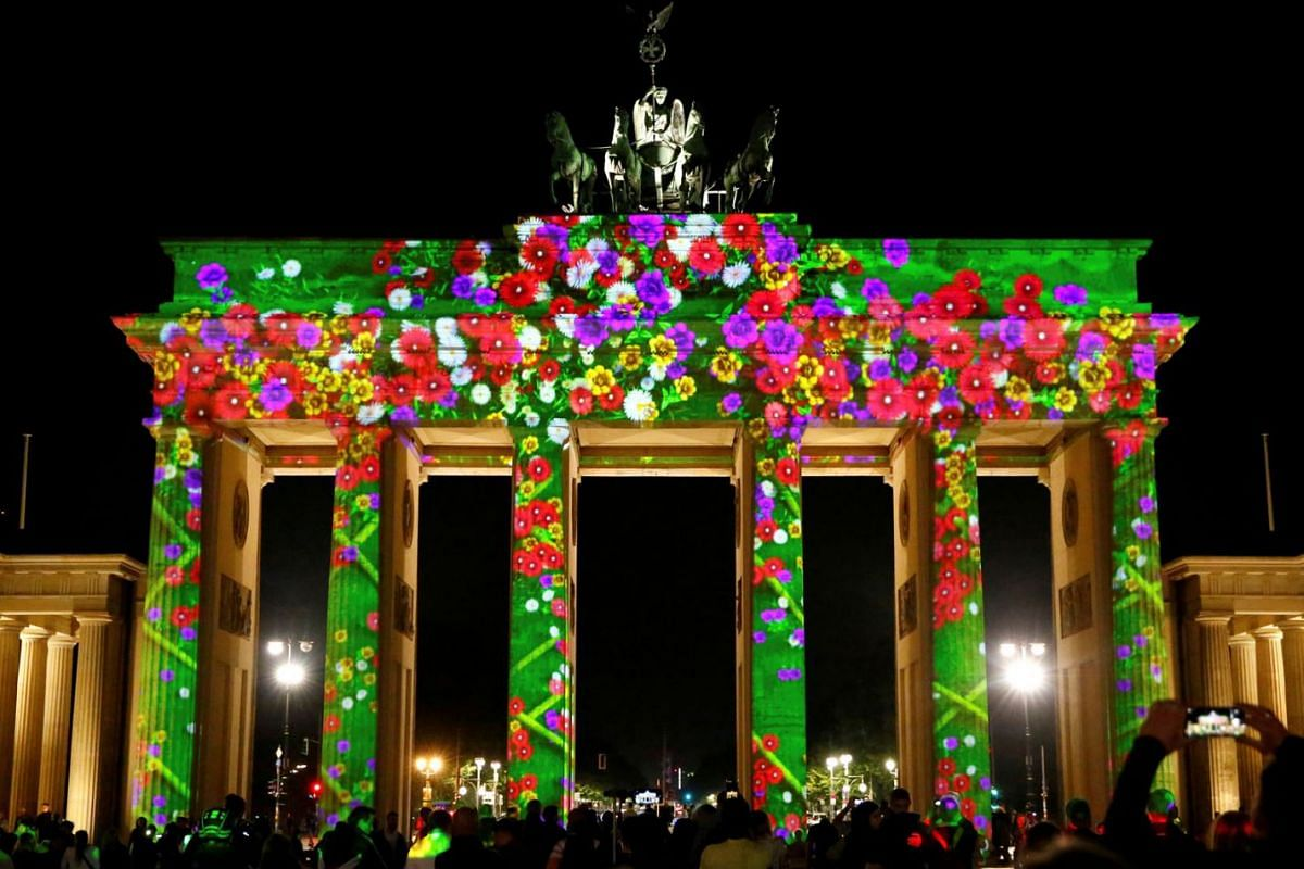 The Brandenburg Gate is illuminated during the Festival of Lights show in Berlin, Germany, September 3, 2021.