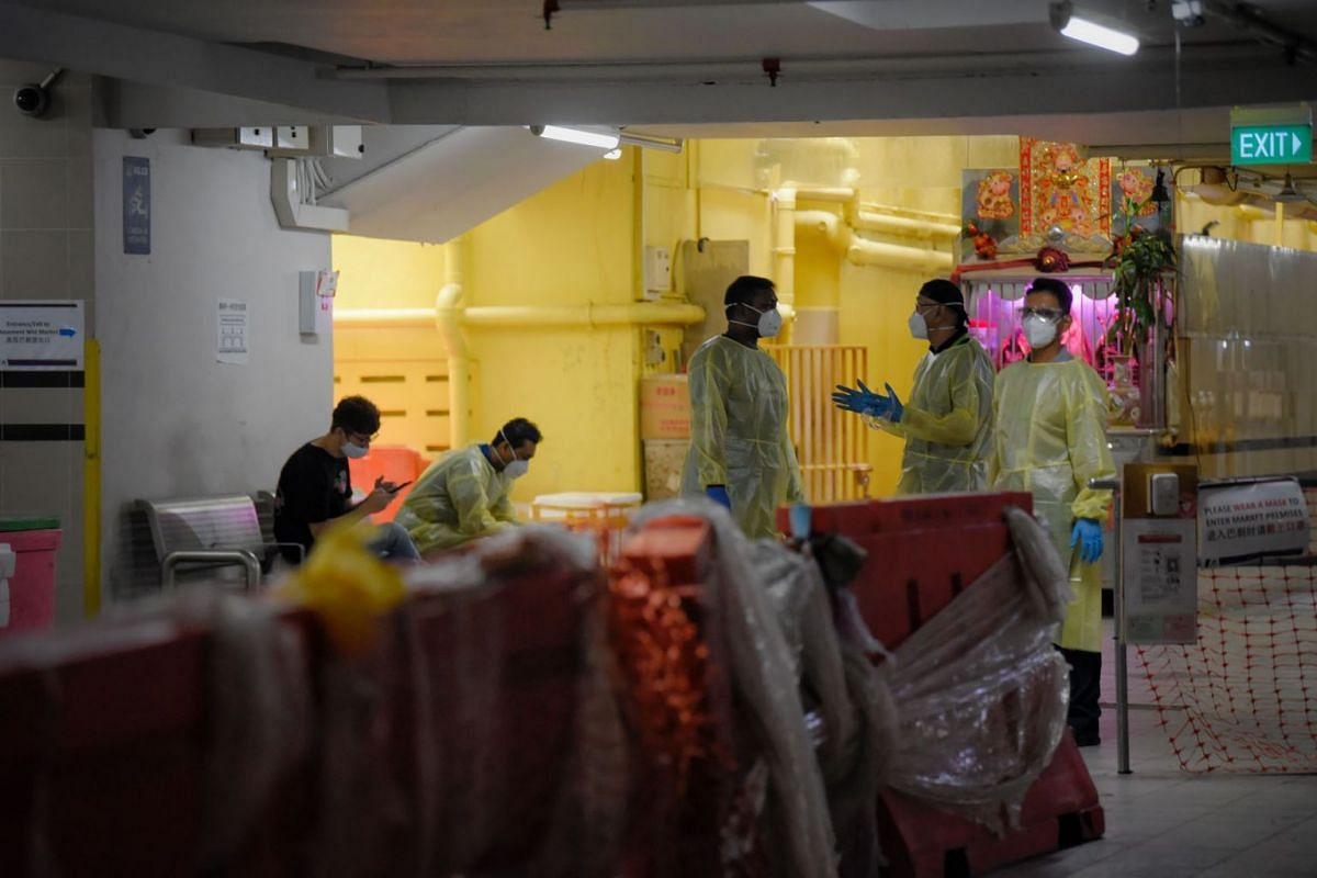 Personnel in PPE are seen at the wet market section of Chinatown Complex as deep cleaning takes place on September 13, 2021. The Ministry of Health (MOH), in a late night notice on Saturday, said 66 cases have been linked to a cluster in Chinatown Co