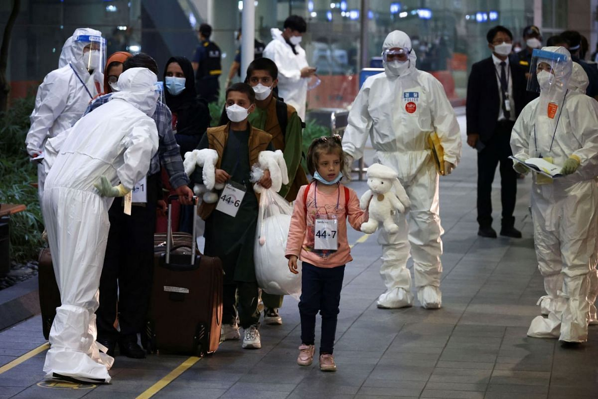 Afghan evacuees, who supported the South Korean government's activities in Afghanistan, arrive at Incheon International Airport in Incheon, South Korea, August 26, 2021.