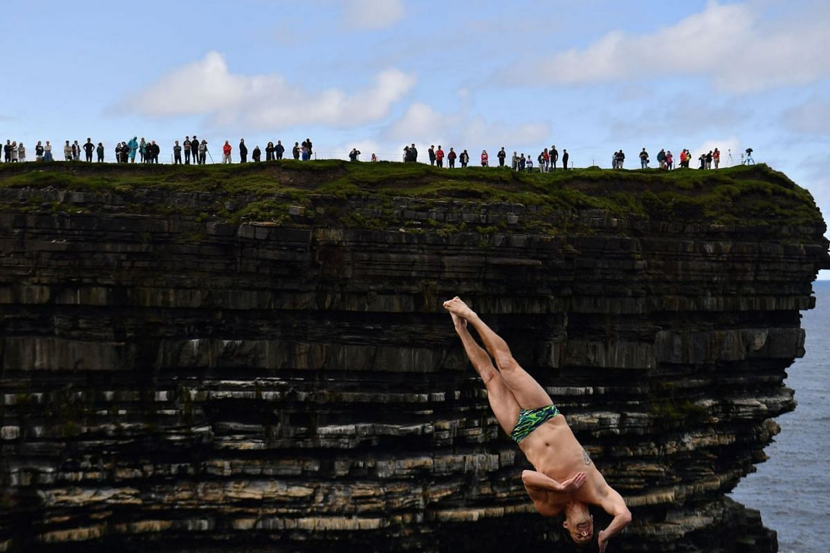 Steven LoBue of USA dives during the 2021 Cliff Diving World Series in Downpatrick Head, Ireland, September 12, 2021.