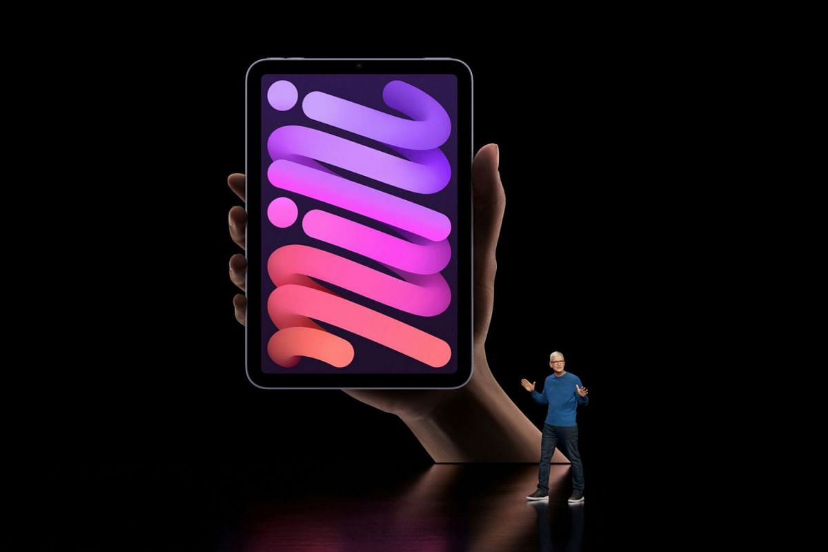 Apple CEO Tim Cook unveils the new iPad mini during a special event at Apple Park in Cupertino, California broadcast September 14, 2021.