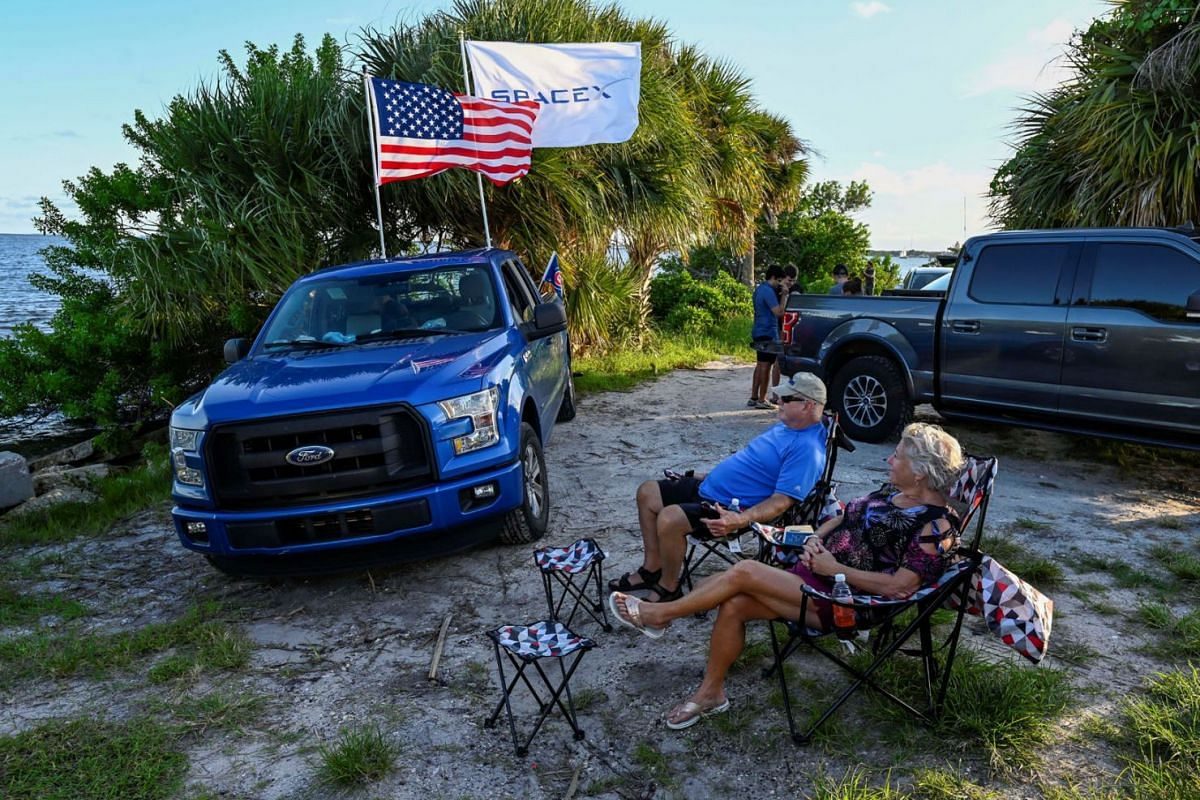 David and Nora Thurman wait to watch the launch of the SpaceX Falcon 9 rocket carrying the Inspiration 4 civilian crew, as they sit along the Indian River Lagoon in Titusville, Florida, September 15, 2021.