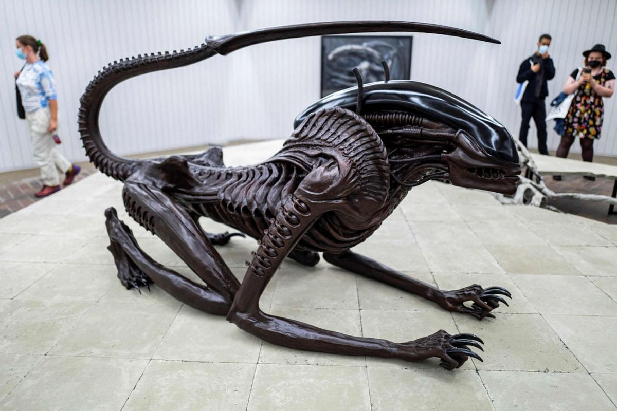 """Swiss artist HR Giger's sculpture """"Necronom (Alien III)"""" is on display as part of the """"HR Giger & Mire Lee"""" exhibition, at the Schinkel Pavillon gallery in Berlin, on September 15, 2021, during the Berlin Art Week."""