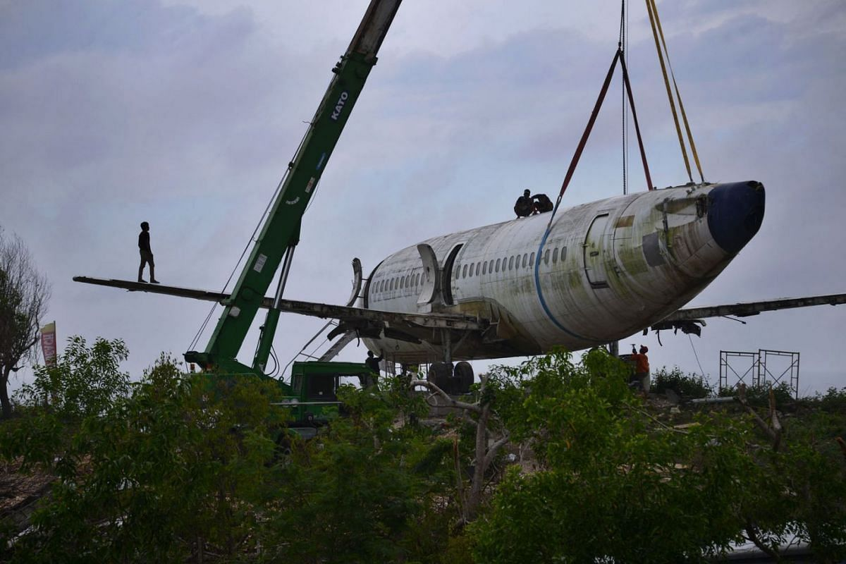 A photo taken on September 16, 2021,  shows a retired Boeing aircraft placed on a seaside cliff to lure tourists and be turned into a villa near Nyang-Nyang beach in Uluwatu Badung Regency, on Indonesia resort island of Bali,  September 14, 2021.