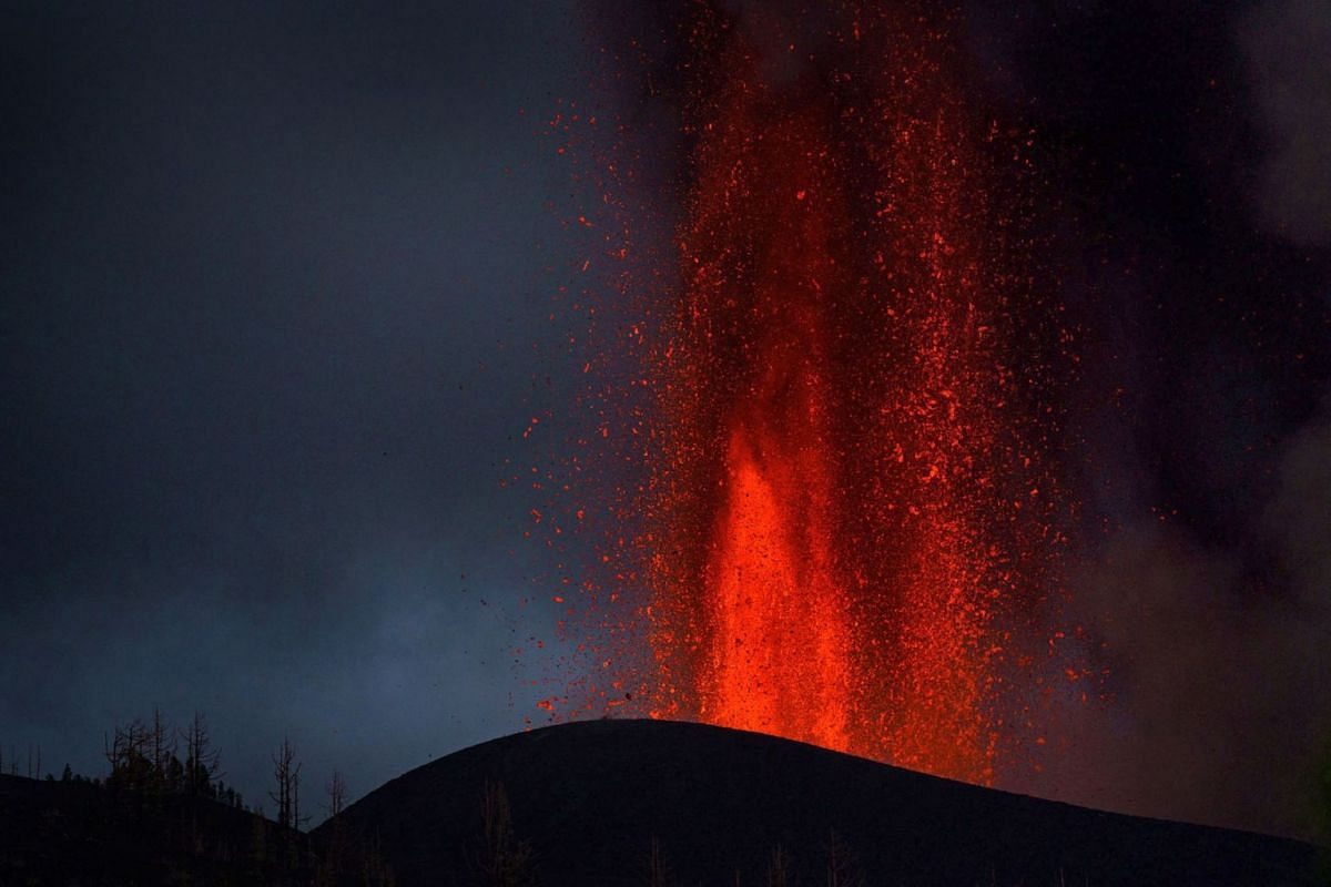 Lava and smoke rise during a volcanic eruption in La Palma, Canary Islands, September 22,  2021. The Cumbre Vieja volcano began to erupt in Montana Rajada in the municipality of El Paso on September 19.