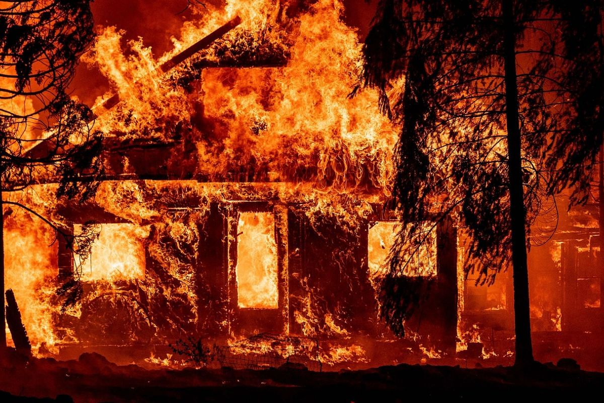 In this file photo taken on July 24, 2021, a home burns as flames from the Dixie fire tear through the Indian Falls neighbourhood of unincorporated Plumas County, California.