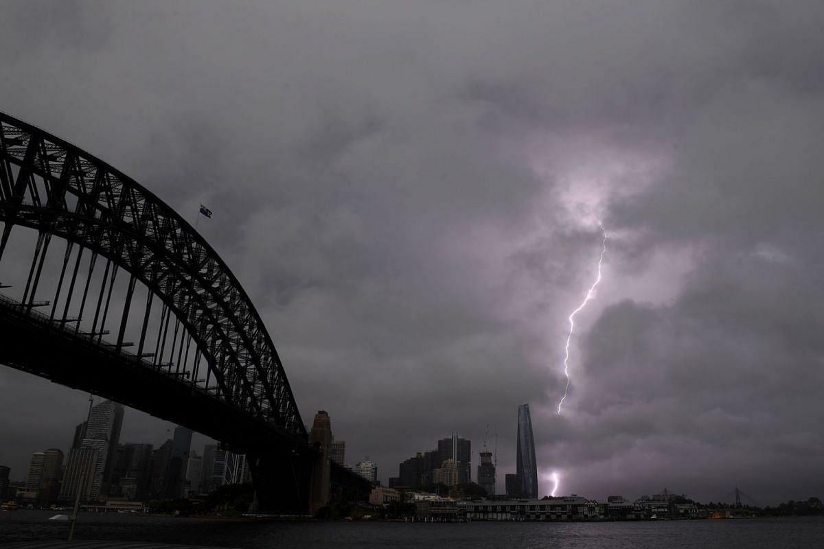 Storm clouds and lightning are seen in Sydney, Australia, October 14, 2021.