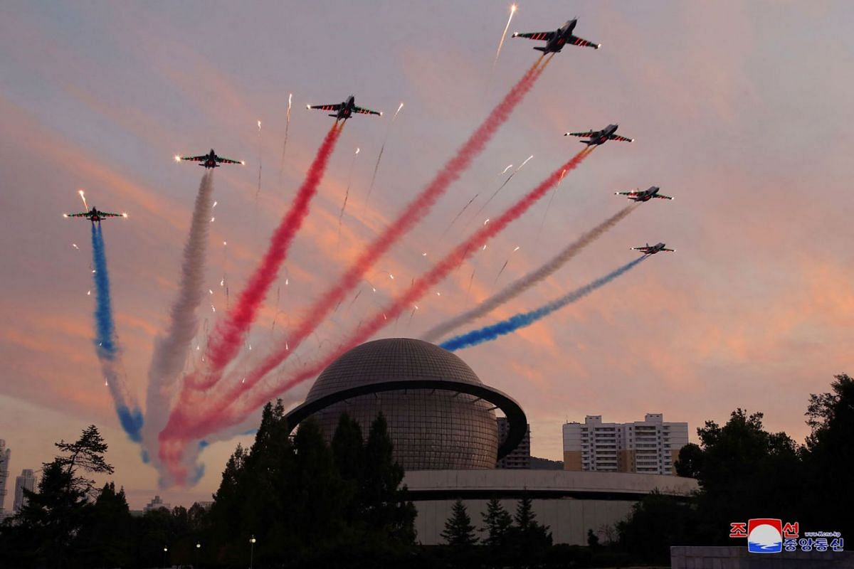 Military planes perform a flypast during the Defence Development Exhibition, in Pyongyang, North Korea, in this undated photo released on October 12, 2021 by North Korea's Korean Central News Agency (KCNA).