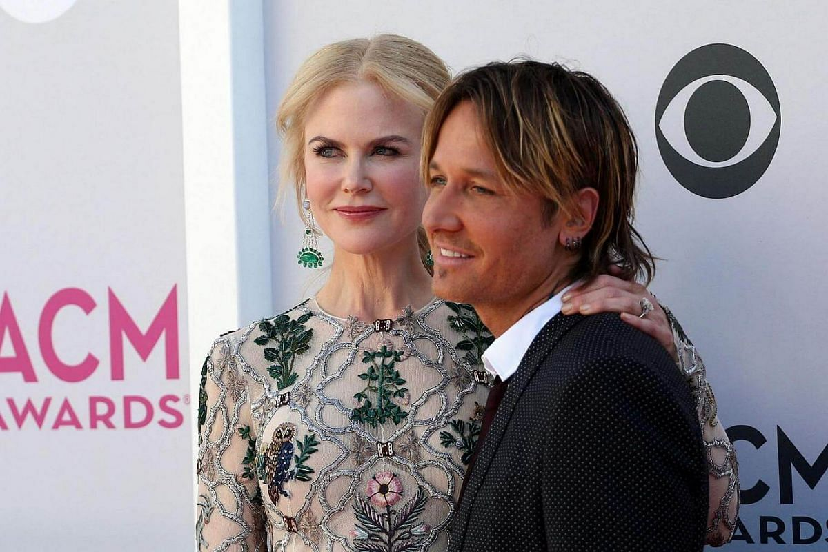 Australian actress Nicole Kidman and New Zealand-born Australian-American country musician Keith Urban pose as they arrive for the 52nd Academy of Country Music Awards.