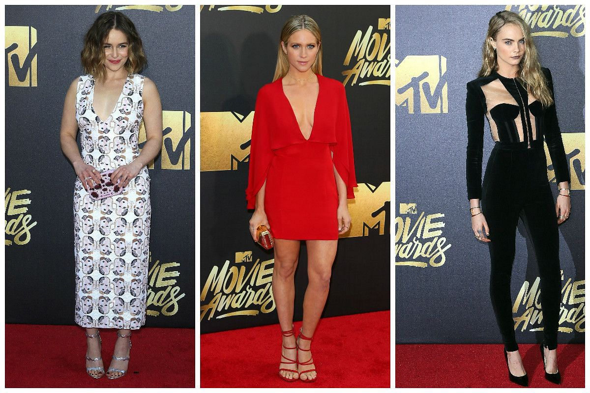 (From left) Actresses Emilia Clarke, Brittany Snow and Cara Delevingne arrive at the 2016 MTV Movie Awards in Burbank, California, on April 9, 2016.