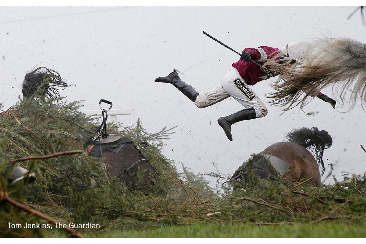 First Prize Sports (Singles) category. Jockey Nina Carberry flies off her horse Sir Des Champs as they fall at The Chair fence during the Grand National steeplechase during day three of the Grand National Meeting at Aintree Racecourse on April 9, 201