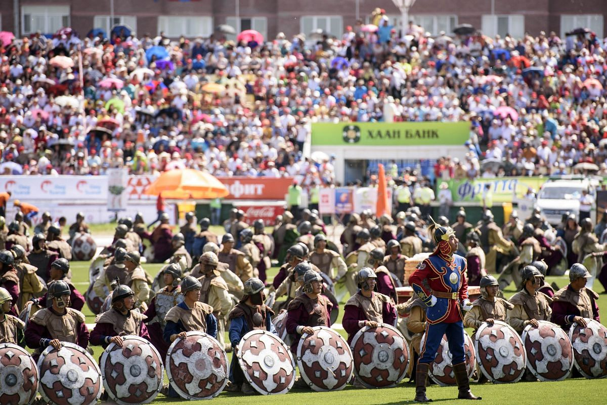 Actors dressed as Mongolian soldiers taking part in the opening ceremony of National Naadam Festival at the Central Stadium in Ulan Bator.