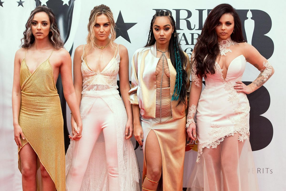 Jade Thirlwall, Perrie Edwards, Leigh-Anne Pinnock and Jesy Nelson from girl group Little Mix arriving at London's O2 Arena.
