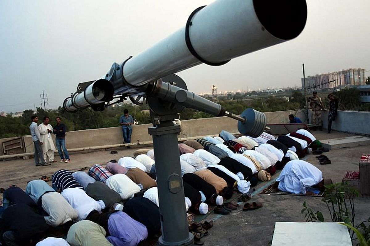 Members of the official committee to announce the sighting of the crescent moon, which signifies the start of Ramadan, at evening prayers in Karachi, Pakistan.
