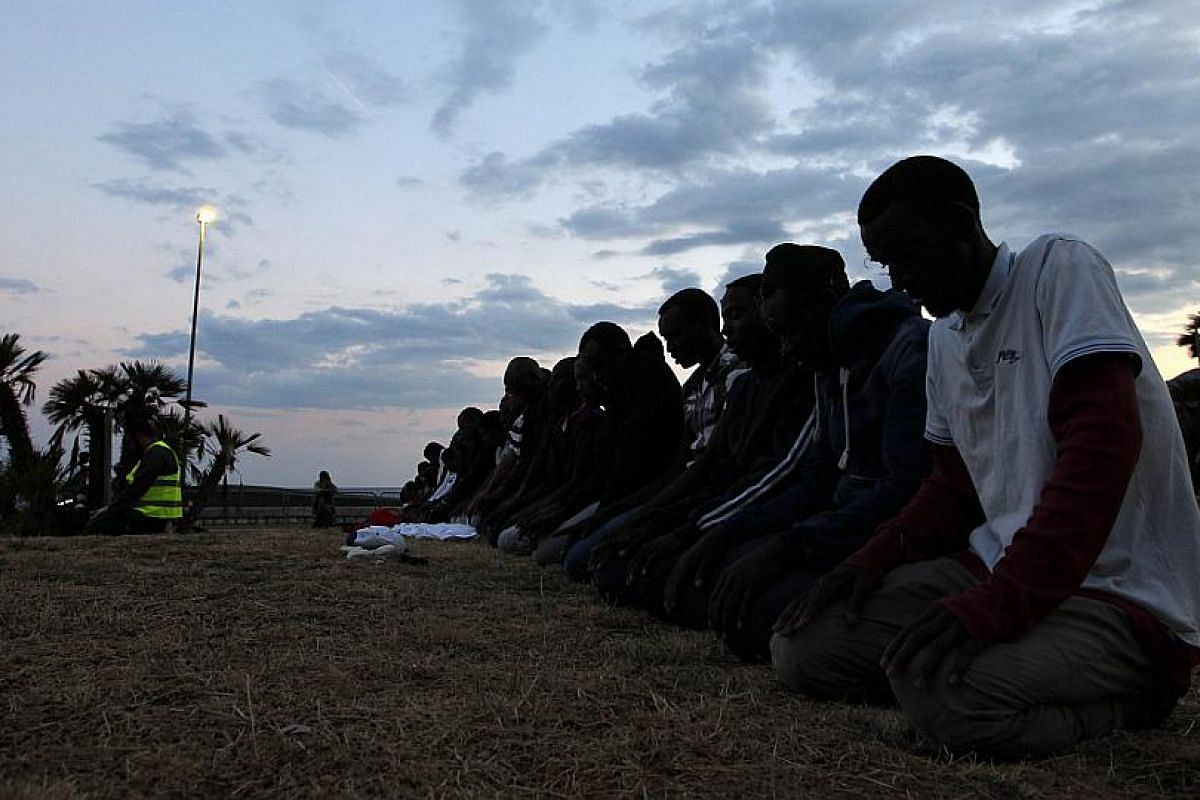 Migrants praying on the eve of Ramadan in the Italian city of Ventimiglia, near the French border.