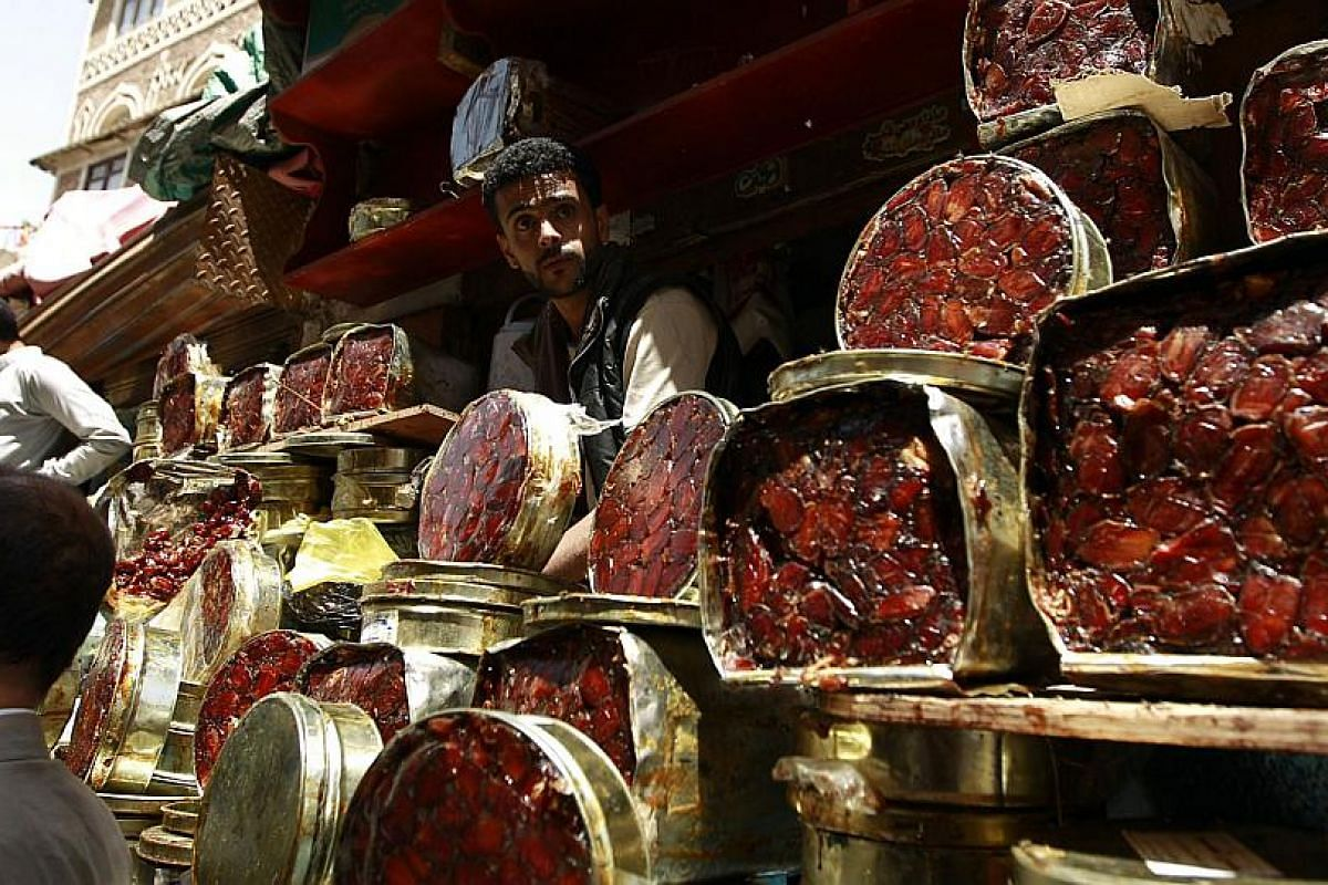 A Yemeni vendor selling dates, a staple food for breaking fast during Ramadan, at a market  in the Yemeni capital Sanaa.