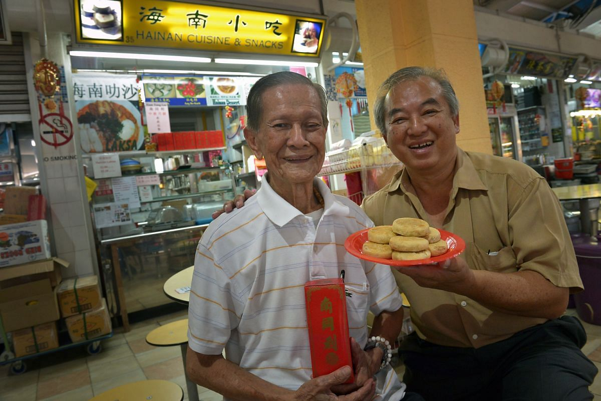 Mr Wee Chow Ann (far left) and his nephew Wong Eng How with Nam Tong Lee Confectionery's signature Hainanese mooncakes, and Poh Guan Cake House owner Chan Kim Ho (above) with his traditional Teochew mooncake.