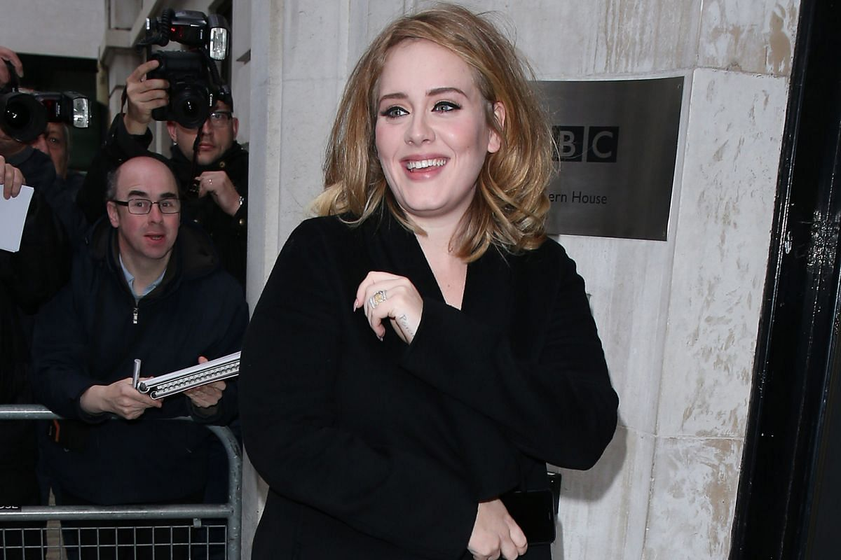 Adele, in London last Friday, has a new look (left) featuring a trendy, shoulder-length bob and more natural-looking make-up. She had heavier make-up and big curls (top) in 2013 and a bouffant (above) earlier this year.