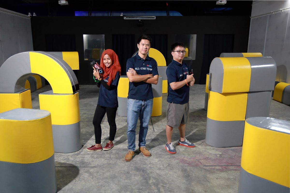 (From far left) Events management intern Adilah Imran, director John Lim and assistant manager Carl De Leon of Tag Team Inc, which is having a promotion at its Downtown East branch.