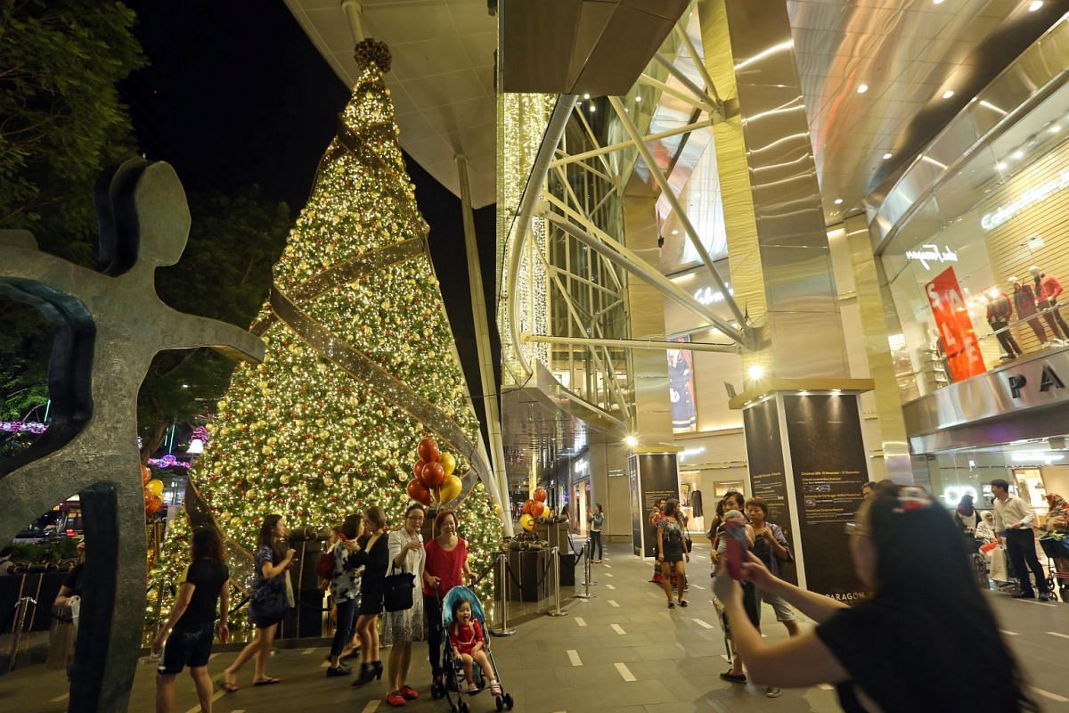 Far left: Westgate mall journeys into Christmas future with galactic-themed decorations such as interstellar baubles and futuristic trees that bring to mind the Milky Way. Left: At Paragon, a 12m-tall tree in shimmering gold enchants shutterbugs youn