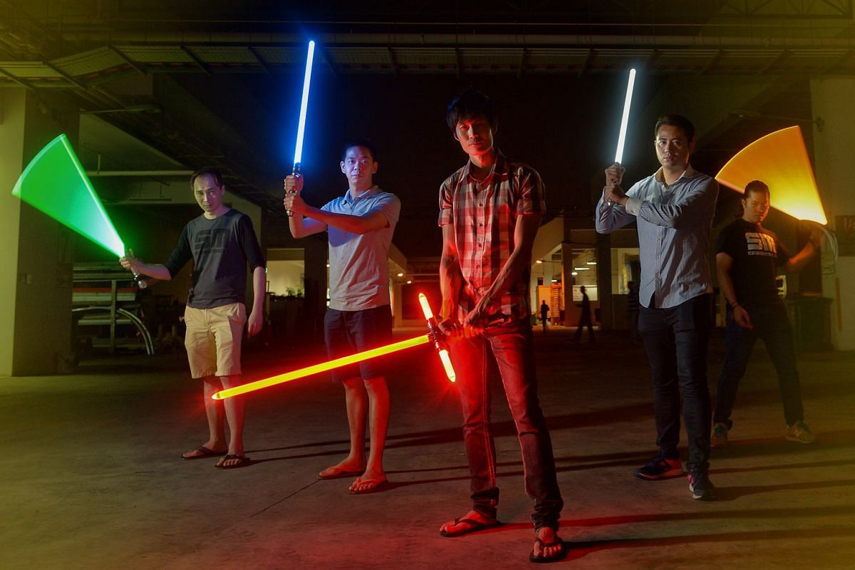 SaberMach founder Jay Chen (centre) with (from far left) its marketing director Gary G. Tevan, his friends Chen Hong and Edwin Yap, and SaberMach creative director Kit Woo.
