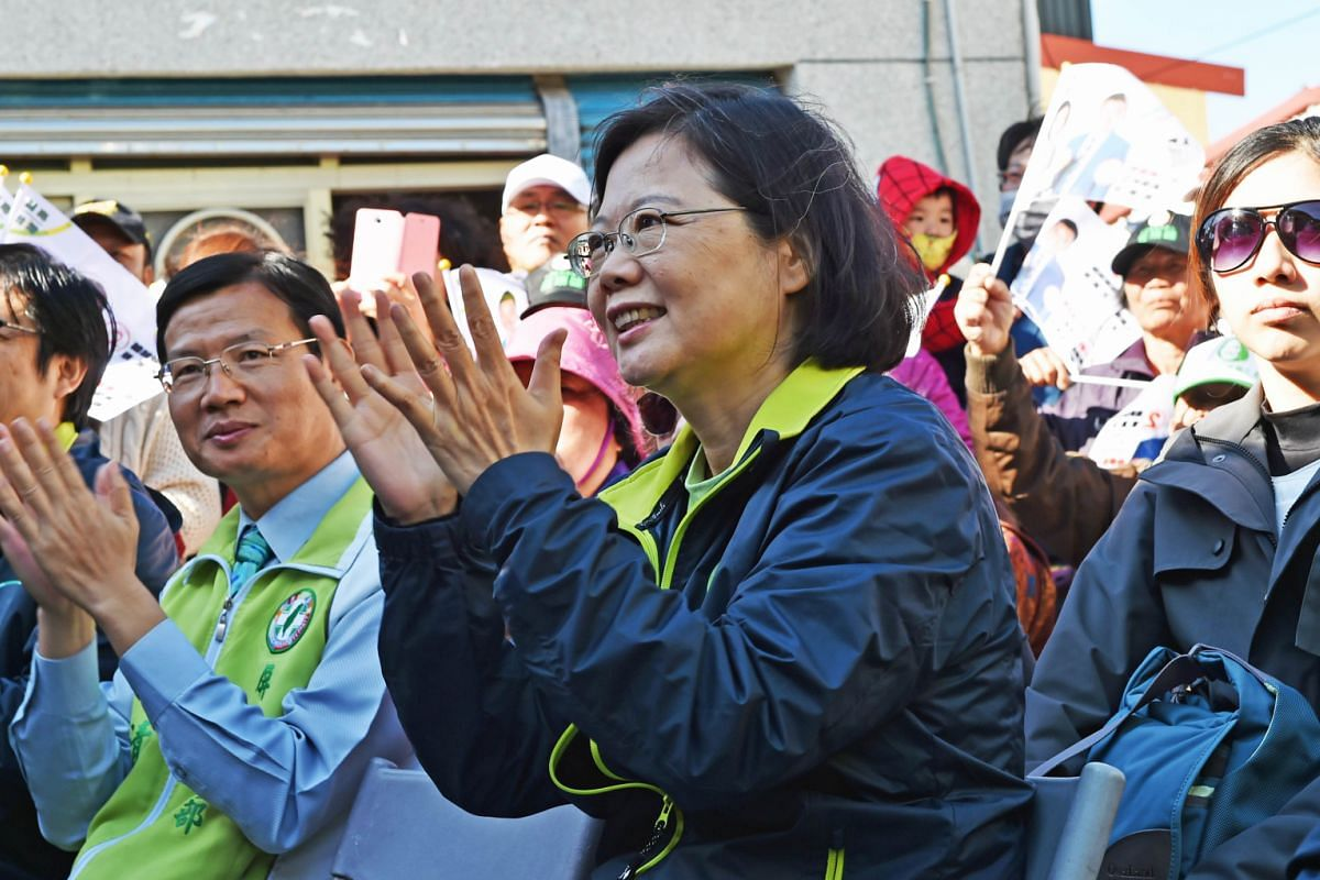 KMT'S Mr Chu at a glitzy rally in northern Taoyuan on Sunday. He is struggling to win support as the KMT's popularity has fallen over its China-friendly policies. PFP's Mr Soong and his running mate, Ms Hsu Hsin-ying, on Nov 24. At a Taipei temple, h
