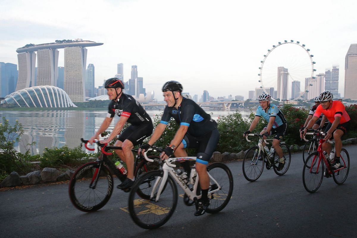 Chef Gordon Ramsay (foreground, left) cycling along East Coast Parkway.