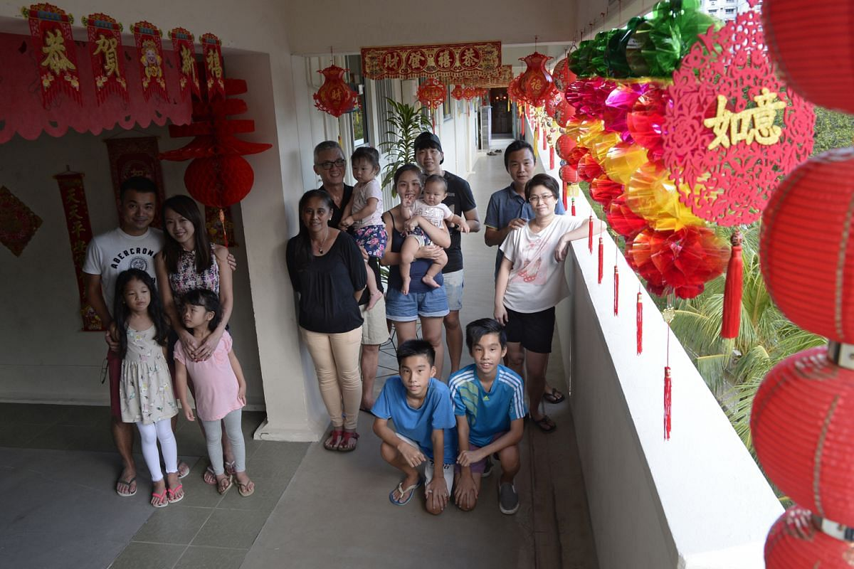 From left: The Seows, comprising Stanneth Seow, 38, his wife Coreen, 40, and daughters Megan, eight, and Carmen, five; the Yongs, comprising Yong Teck Shing, 52, his wife Goon Huk, 50, their youngest daughter Yi Ping, 25, with husband Eddie Lau,