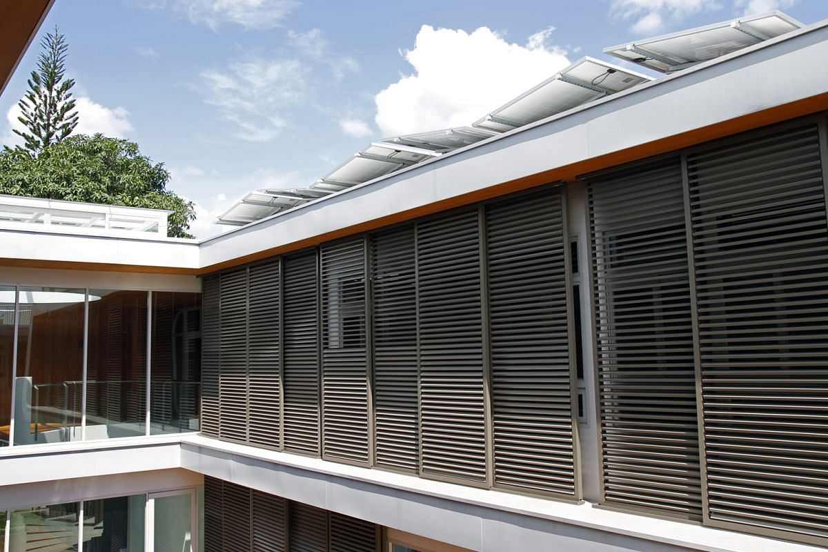 Windows on the north and south facades facilitate cross-ventilation and let natural breeze flow between opposite sides of the house off Dunearn Road. Shutters (above) help reduce the sun's rays entering the $6-million home.