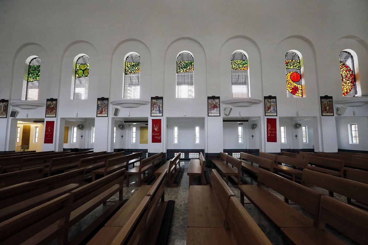 Arches frame stained-glass artworks (above) in the chapel of St Patrick's School.