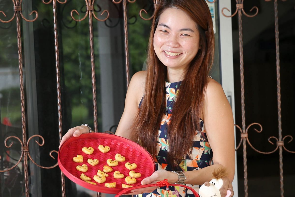 Ms Yeo (above) tweaked an online recipe for salted egg cookies by adding icing sugar and corn flour and garnishing with flaxseeds.