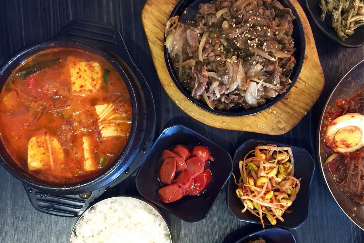 Three Meals A Day's kimchi jjigae (left) and beef bulgogi.