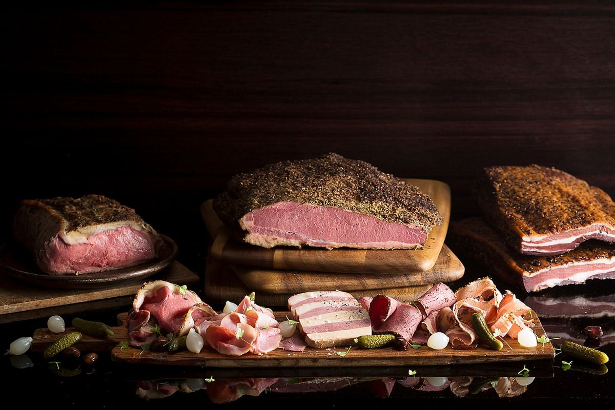 The Ash & Elm Platter includes meats such as house-cured beef pastrami and house-smoked pork loin.