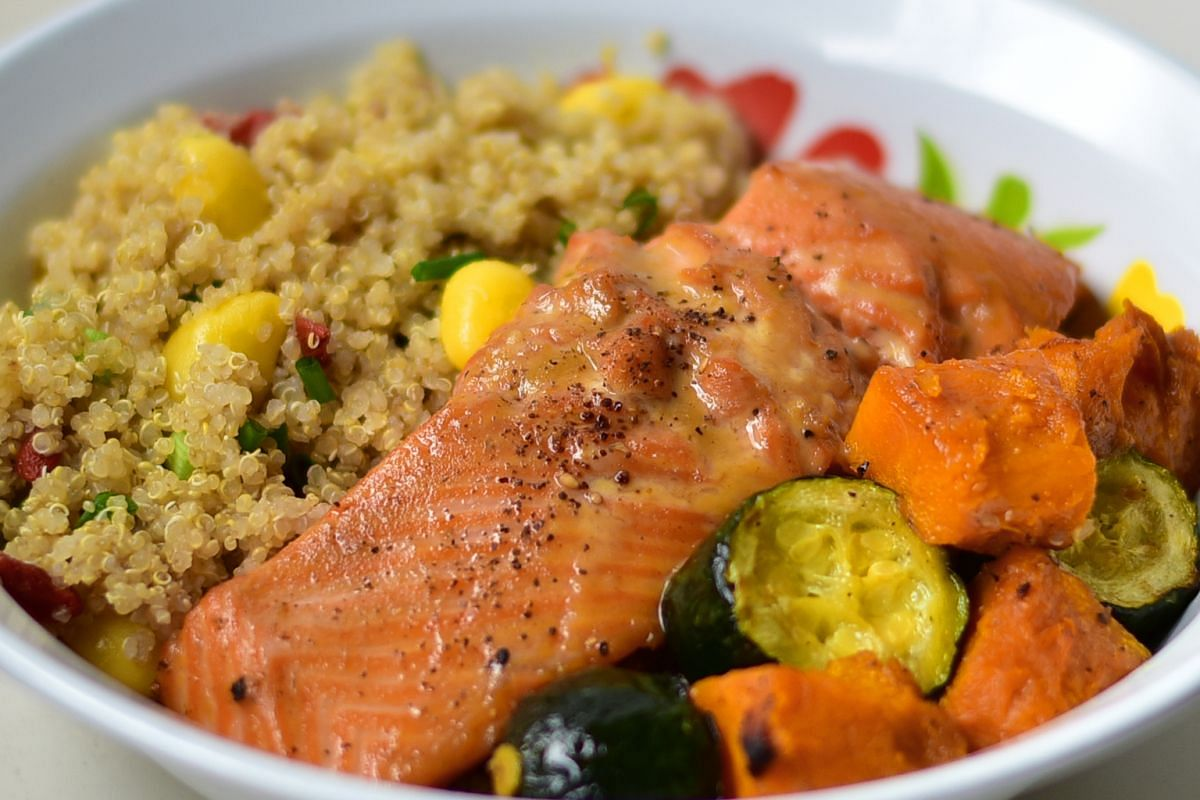 Quinoa with roast salmon and vegetables makes for a substantial lunch.
